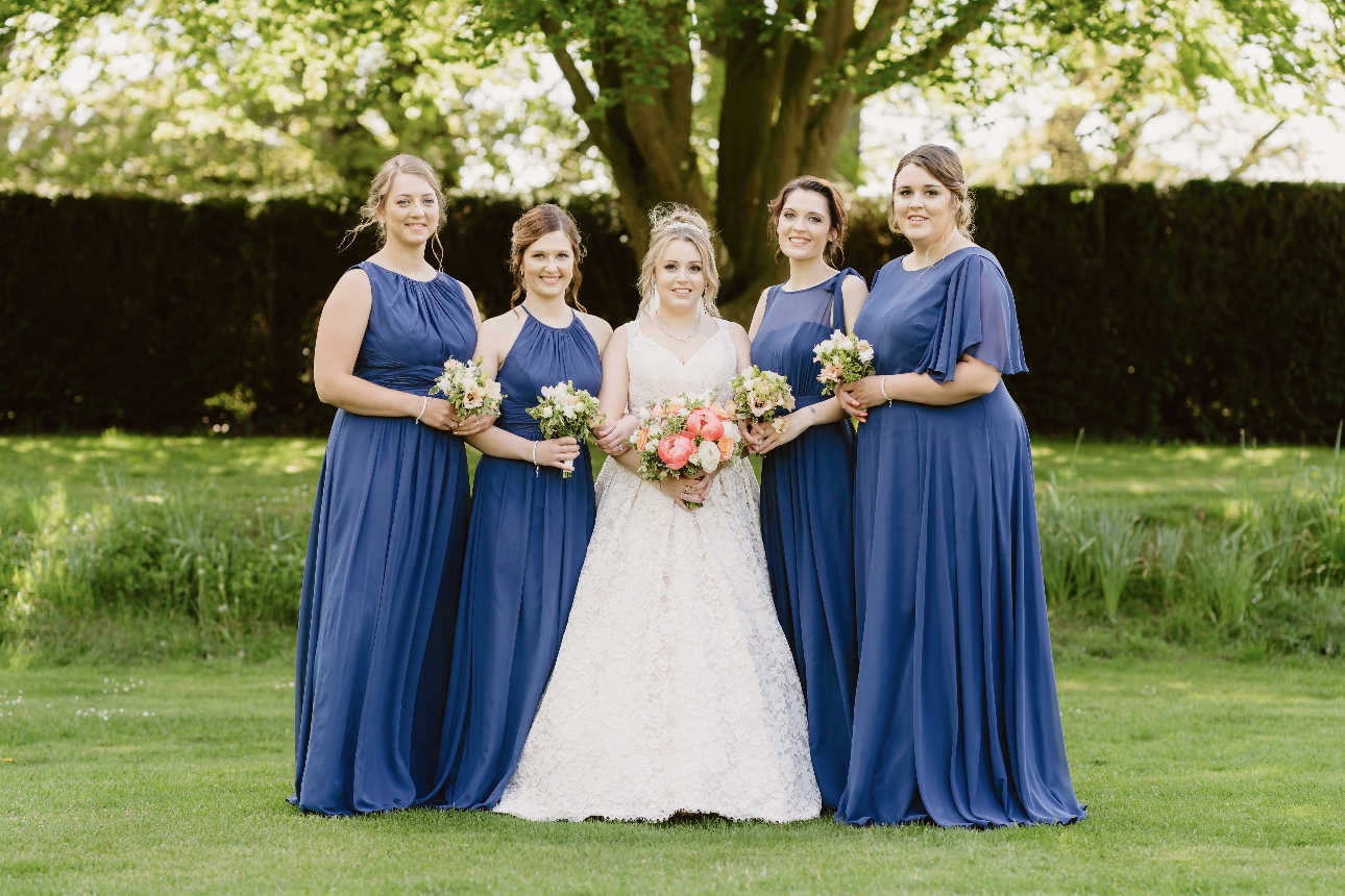 Bridesmaids wore navy dresses from Dessy