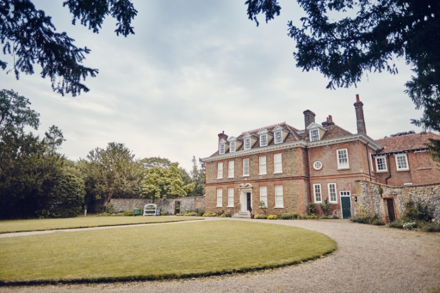 Abbot's Hall outside of brick house on lawn