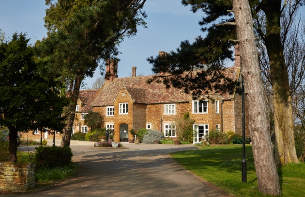 Heacham Manor Hotel, red brick building surround by trees and gravel drive
