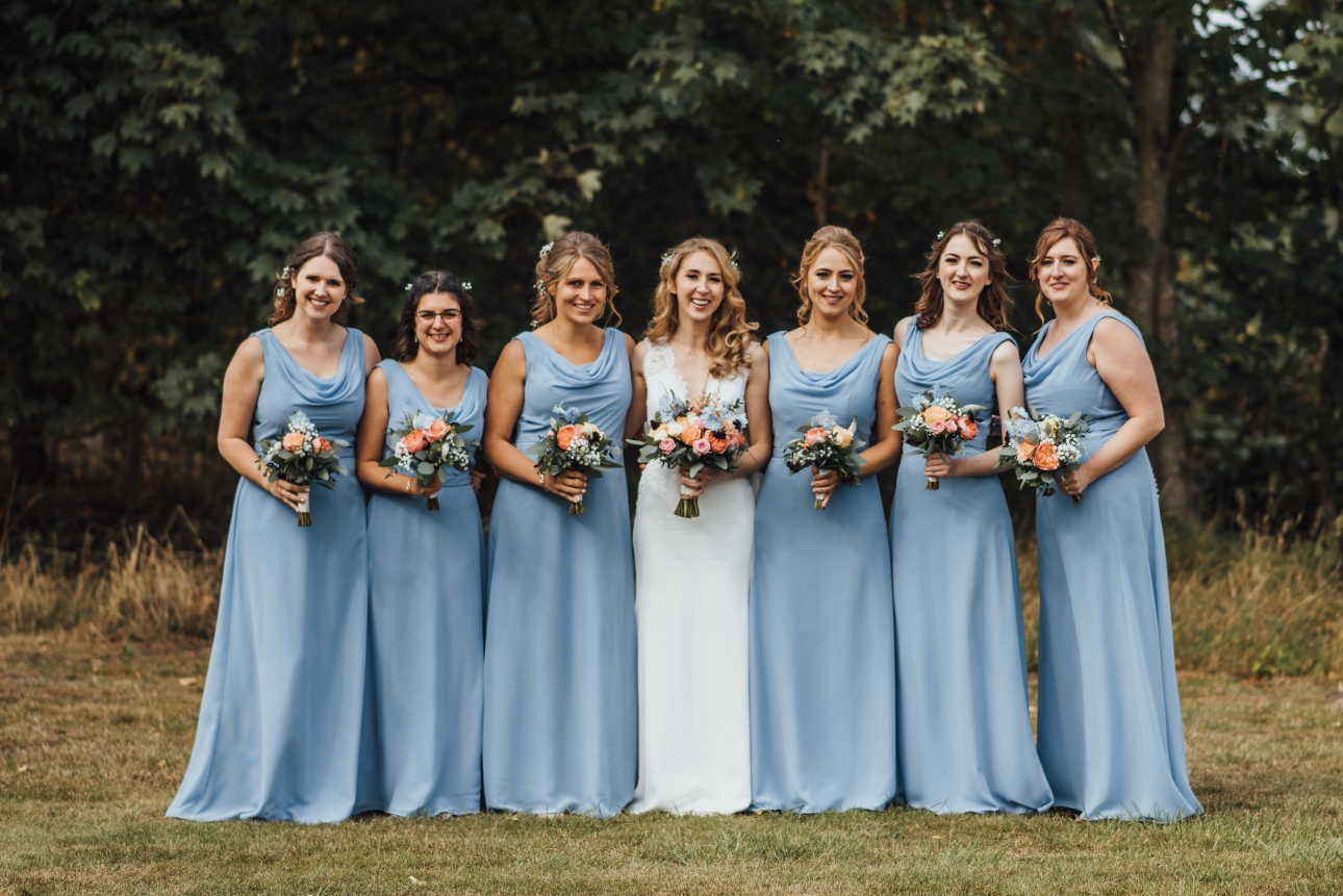 The bride and bridesmaids in blue dresses