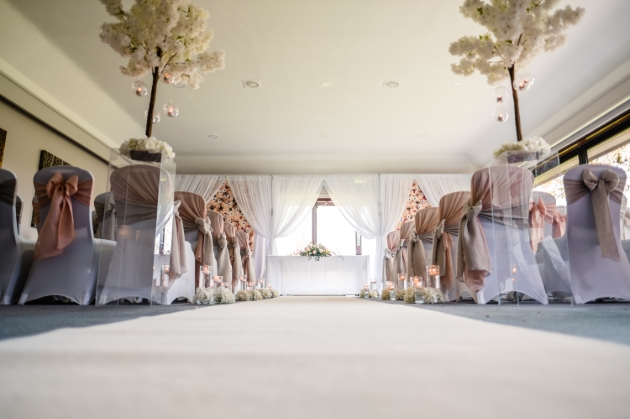 Barnham Broom Hotel, inside ceremony suit set up for wedding with aisle chairs and blossom trees