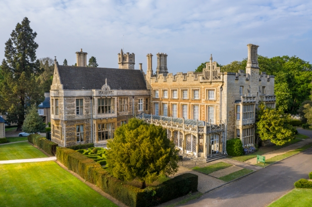 Orton Hall Hotel & Spa, aerial view of historic light-brick house with manicured gardens