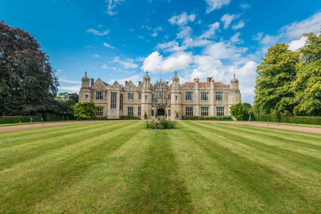 Hengrave Hall, historic house, lawns, trees, blue sky