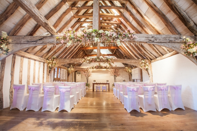 Isaacs on the Quay, ceremony room wooden beams covered in flowers ceremony chairs