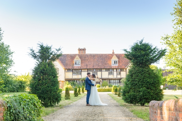 Dove Barn, couple standing on path in front of house