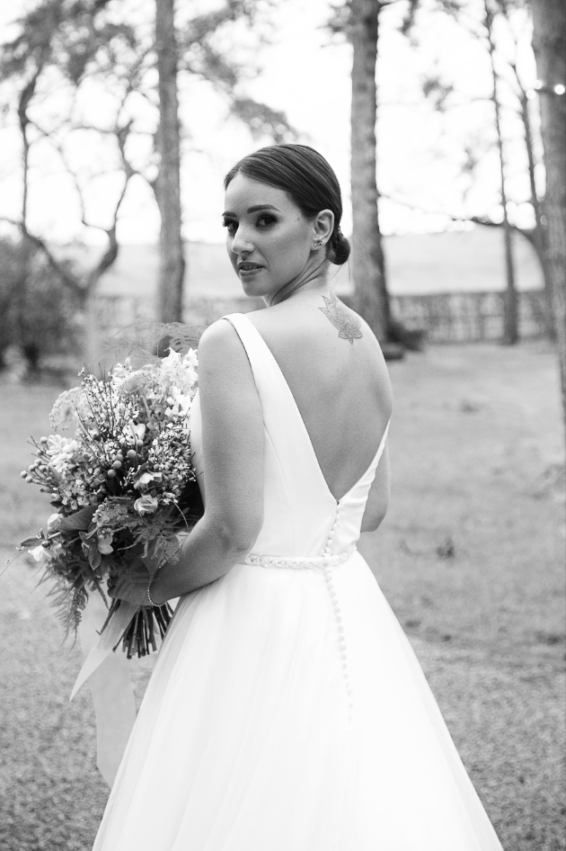 black and white photo of bride wth her back to camera