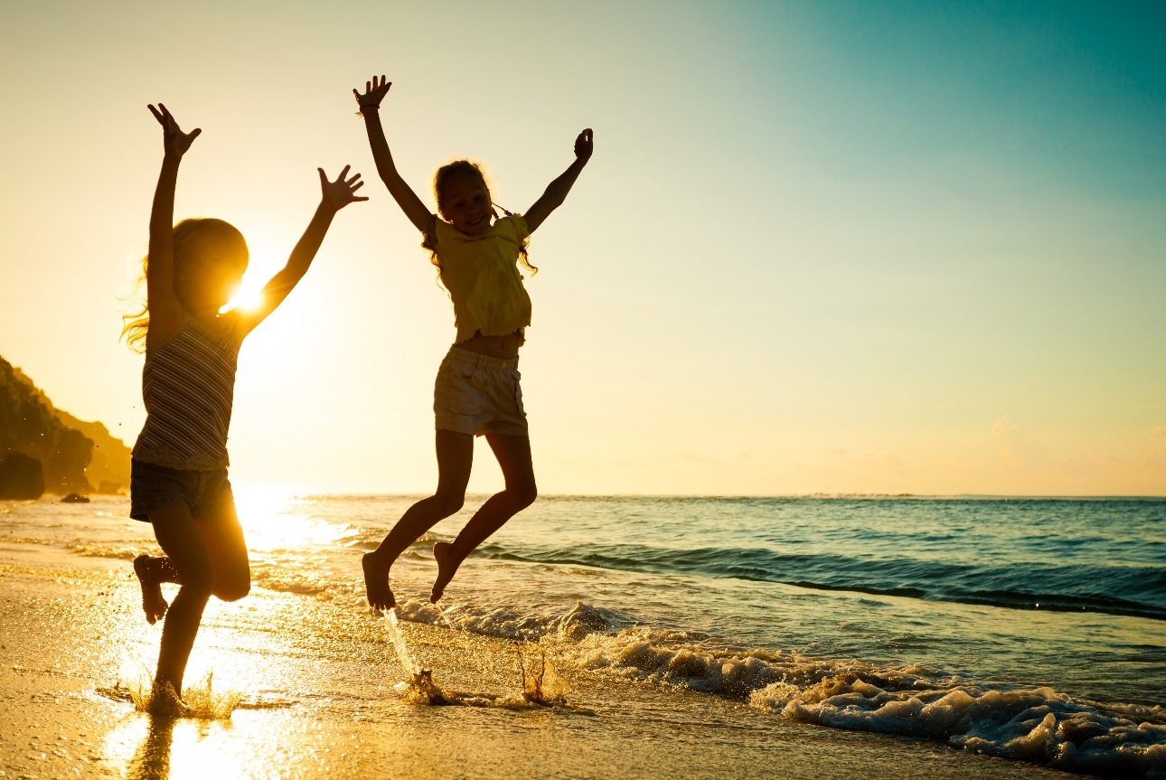 two kids jumping in air