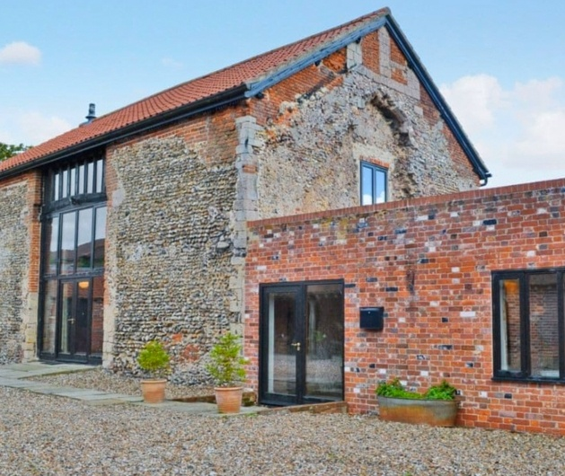 brick barn conversion with panoramic windows