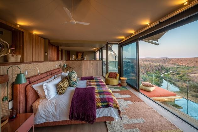 bedroom in lodge with safari views