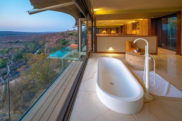 bathroom in lodge with safari views