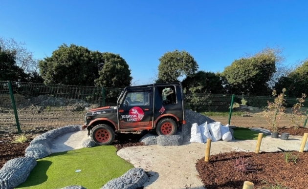 crazy golf with jurassic park jeep