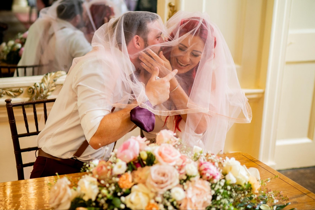 Groom under bride's veil