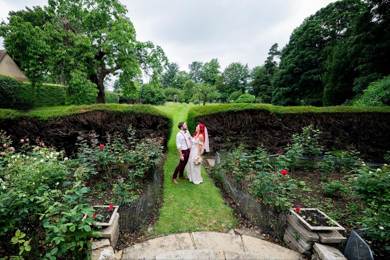 Couple pose in garden