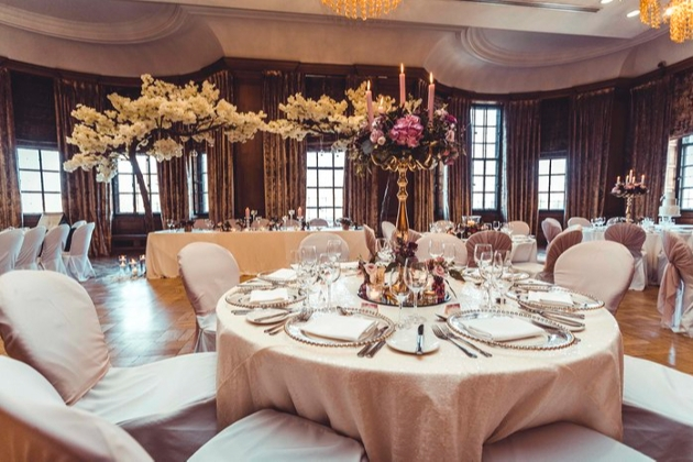 wedding reception room with tables laid out for a wedding breakfast